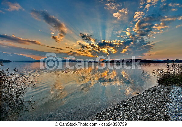 Sunset at lake Chiemsee in Germany - csp24330739