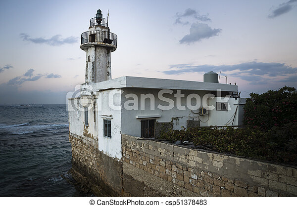 Sunset at old lighthouse in Tyre, Sour, Lebanon - csp51378483