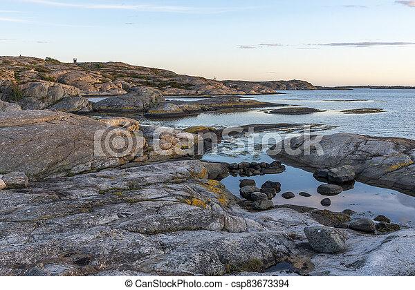Sunset at Orust in Sweden - csp83673394