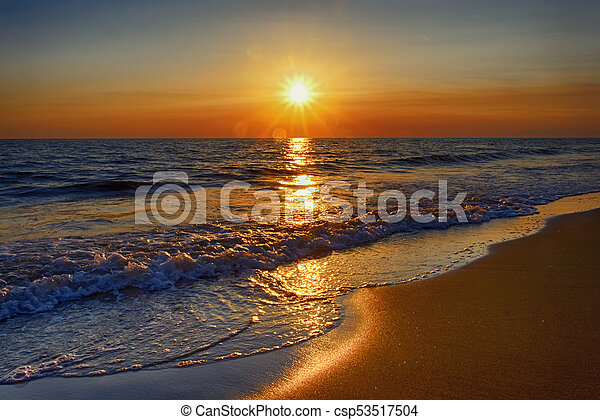 Sunset at sea from the beach - csp53517504