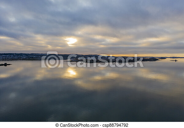 Sunset at sea in winter drone photo - csp88794792