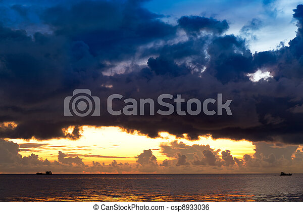 Sunset at South China Sea with threatening sky and ships, Phu Quoc, Vietnam - csp8933036