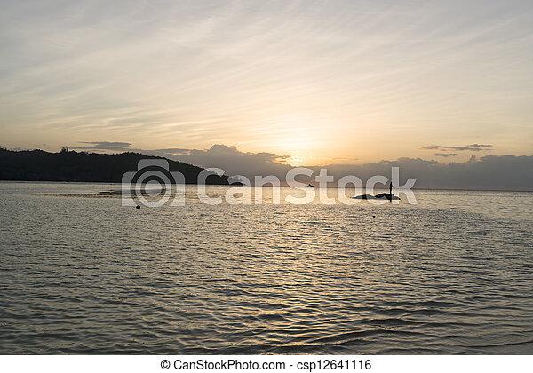 Sunset at the beach - csp12641116