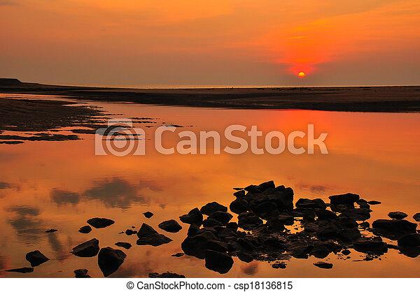 sunset at the beach - csp18136815