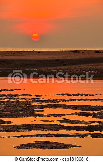 sunset at the beach - csp18136816