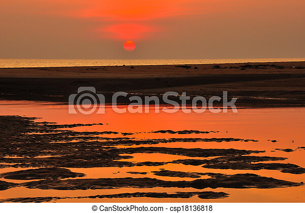 sunset at the beach - csp18136818