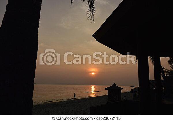 sunset at the beach - csp23672115