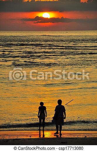 sunset at the beach - csp17713080