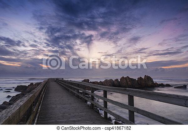 sunset at the beach - csp41867182