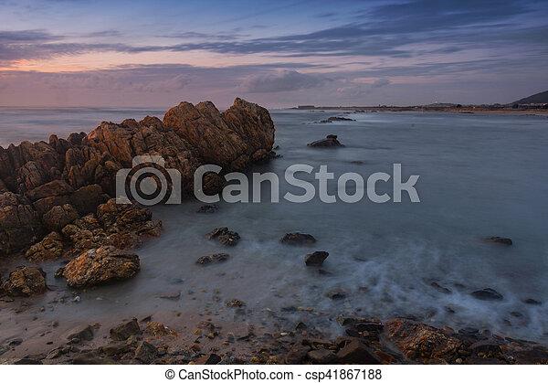 sunset at the beach - csp41867188