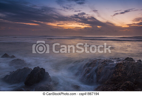 sunset at the beach - csp41867194