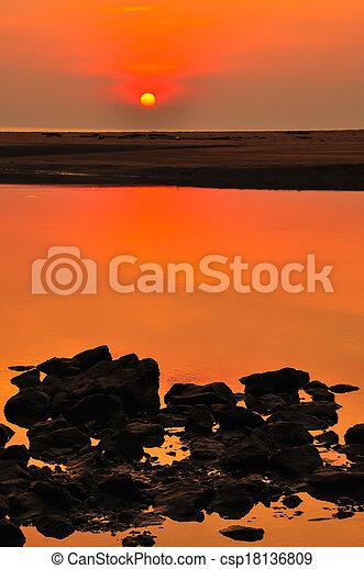 sunset at the beach - csp18136809