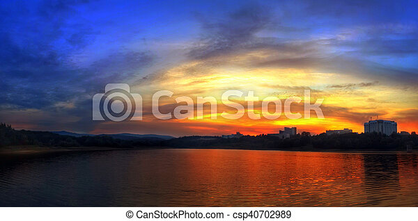 Sunset at the lake in mountains - csp40702989