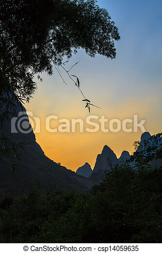 Sunset at the Li river mountains in China - csp14059635