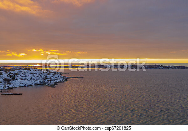 Sunset at the ocean in winter - csp67201825