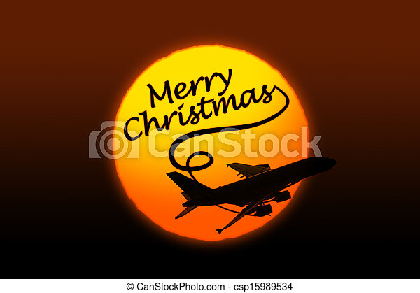 Sunset background with silhouette of airplane and greeting Christmas text - csp15989534