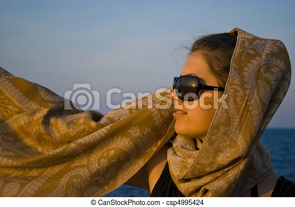 sunset beauty with scarf - csp4995424