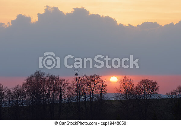 Sunset behind the trees - csp19448050