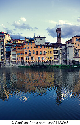Sunset by the river on a background of houses in Florence - csp21128945