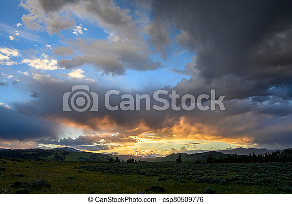 Sunset Highlights Low Clouds in Storm Over Yellowstone - csp80509776