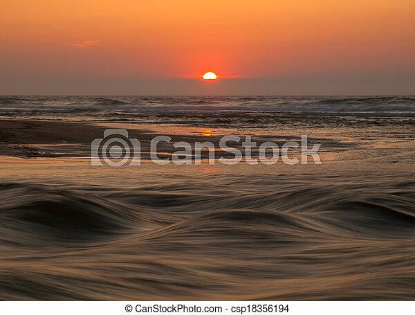 Sunset in a beach - csp18356194