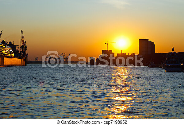 Sunset in port of Hamburg, Germany - csp7198952
