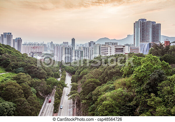 Sunset in residential area of Hong Kong - csp48564726