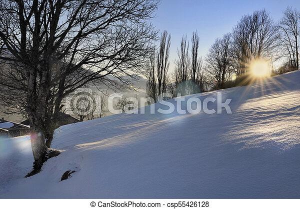 sunset in scenic landscape in winter - csp55426128