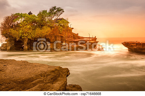 Sunset in Tanah Lot temple, Bali, Indonesia - csp71646668