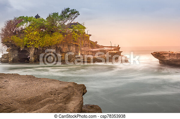 Sunset in Tanah Lot temple, Bali, Indonesia - csp78353938