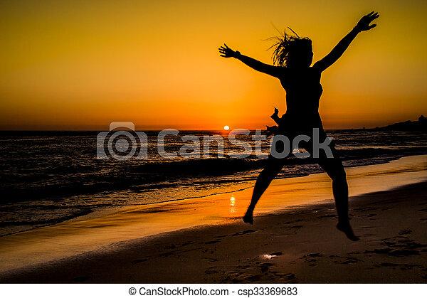 Sunset in the beach - csp33369683