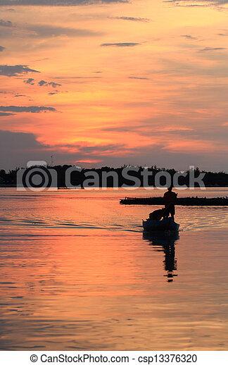 sunset in the beach - csp13376320