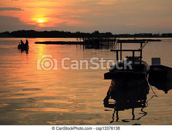 sunset in the beach - csp13376138