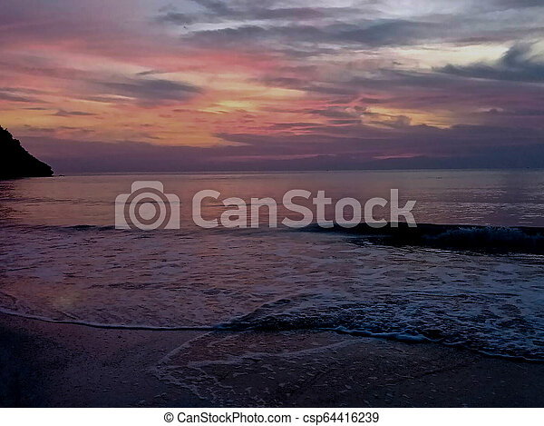 sunset in the beach - csp64416239