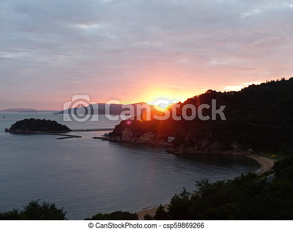 Sunset in the cliff - csp59869266
