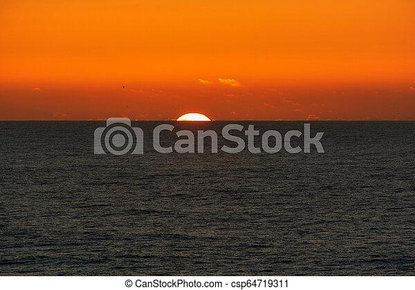sunset in the ocean - csp64719311