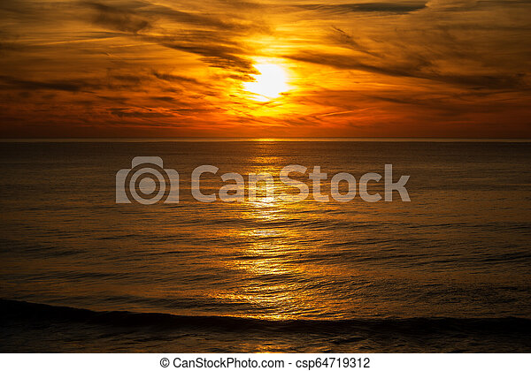 sunset in the ocean - csp64719312