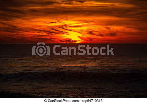 sunset in the ocean - csp64719313
