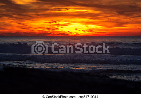 sunset in the ocean - csp64719314