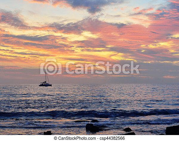 sunset in the ocean - csp44382566