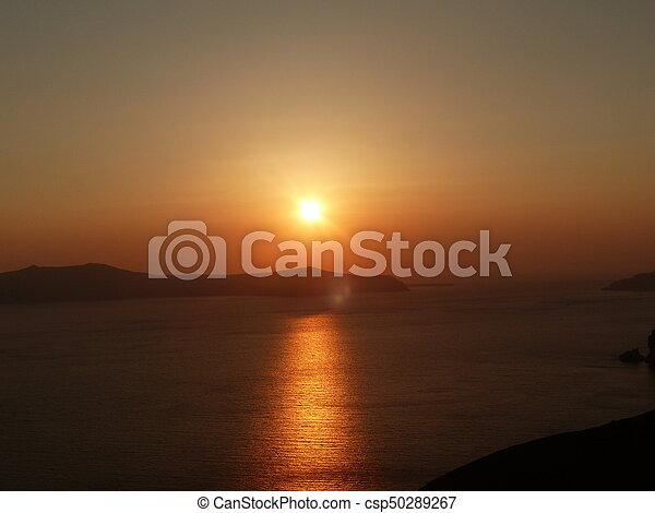 Sunset in the ocean - csp50289267