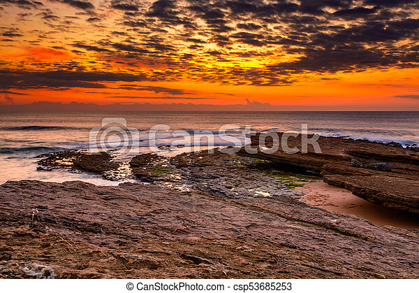 sunset in the ocean - csp53685253