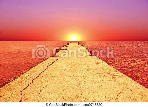 Sunset in the ocean - csp9748530