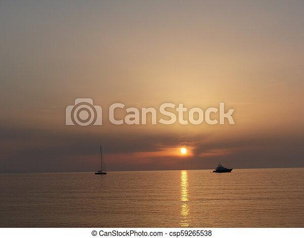 Sunset in the ocean - csp59265538
