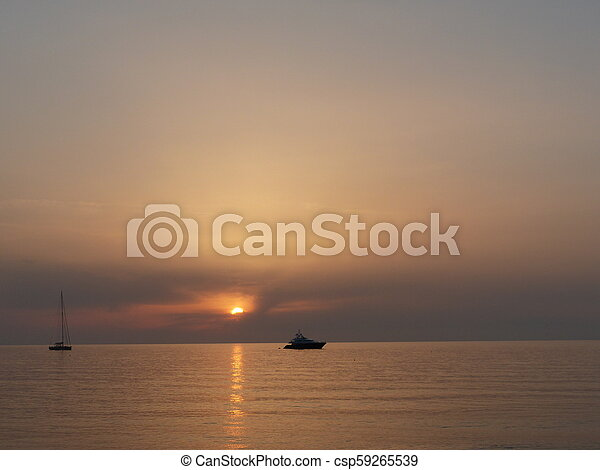Sunset in the ocean - csp59265539