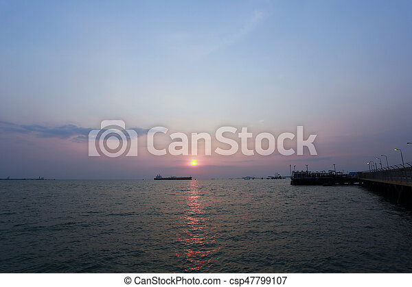 sunset in the sea on evening. - csp47799107