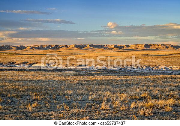 Sunset light over Colorado prairie - csp53737437