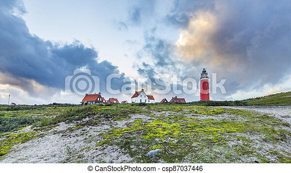 Sunset Lighthouse Texel Netherlands - csp87037446