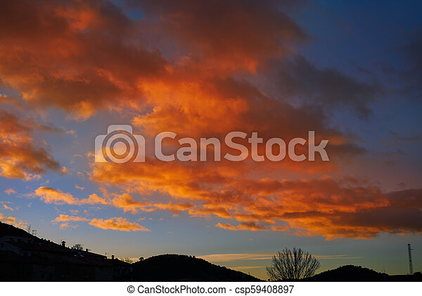Sunset mountain silhouette with orange clouds - csp59408897