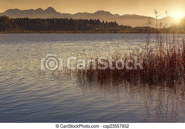 Sunset on a bathing lake in Bavaria, Germany - csp23557932
